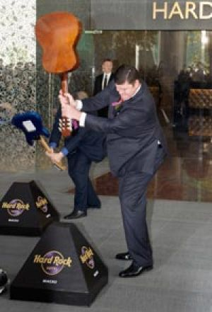 Smashing to do business with  ... James Packer does his best Pete Townshend impersonation at the Hard Rock Hotel opening ...