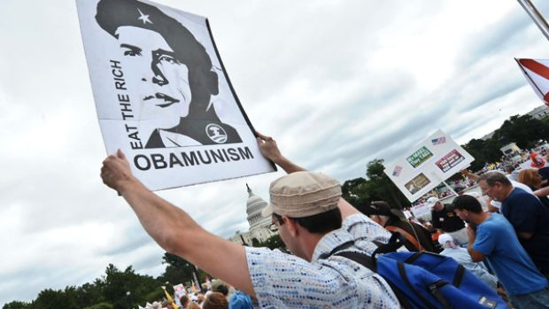 Protesters descended on Washington, some carrying placards lampooning President Barack Obama as a Che Guevara determined ...