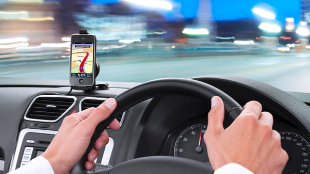 TomTom's new iPhone app in use with the yet-to-be released car-kit.