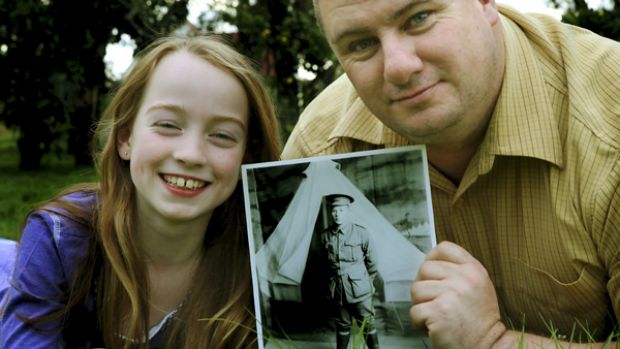 Tim Whitford and daughter Alexandra with a picture of Private Harry Willis.