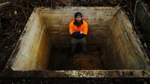 Nathan Amatnieks in a water tank that he wants to convert into a fire bunker.