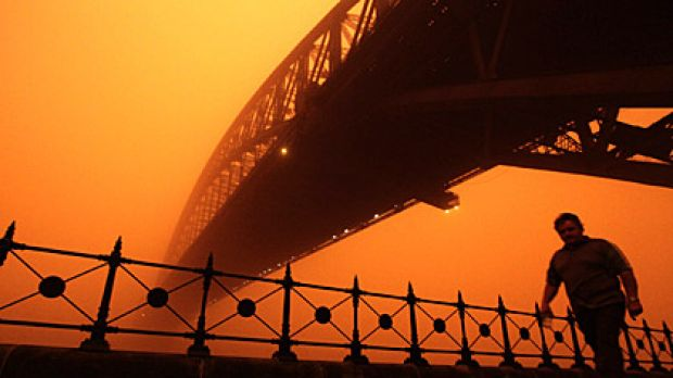 Dust casts an eerie red glow over Sydney on Wednesday.