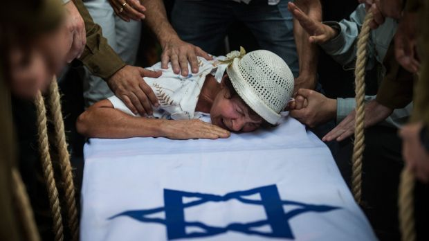 The grandmother of Israeli soldier Jordan Bensimon cries over his coffin in Ashkelon, Israel, during Operation ...