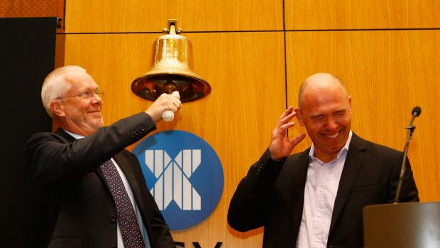 MYOB chairman Justin Milne and CEO Tim Reed ring the bell at the start of trading in MYOB at the ASX.