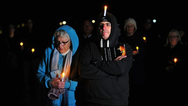 Tara Costigan's grandmother Margaret Costigan and uncle Michael Costigan at the candle lighting ceremony for the ...