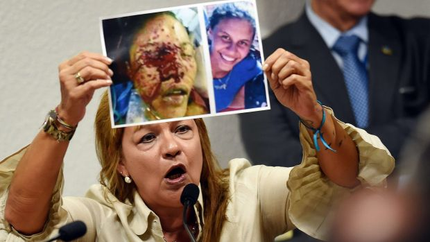 Vera Orozco shows pictures of her daughter Geraldine, killed by members of the Venezuelan National Guard, at a public ...