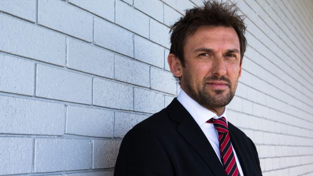 Unfinished business: Tony Popovic is staying with the Western Sydney Wanderers.