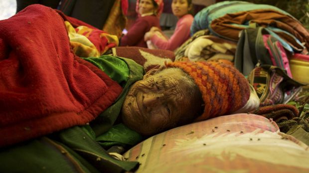 A woman in her 80s beds down in a camp in Ling Ling village.