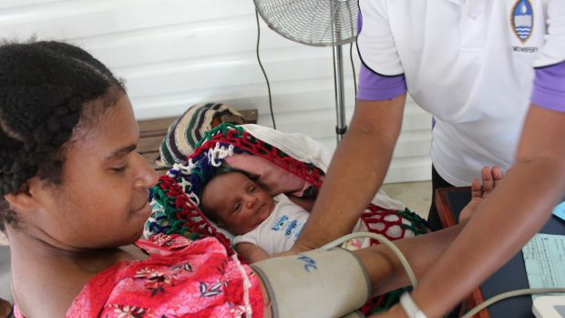 A Port Moresby mother and her newborn get a health check at the Port Moresby General Hospital weekly family planning clinic.