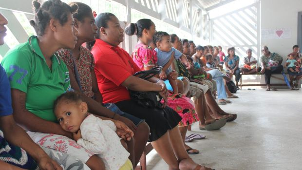 A woman attends a family planning clinic at Port Moresby General Hospital. The weekly clinic is frequently full to ...