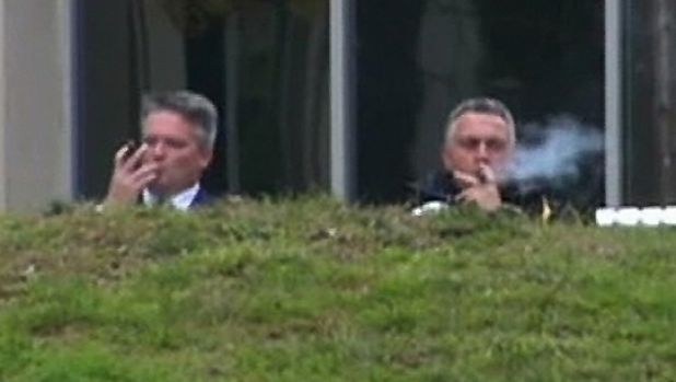 Joe Hockey enjoys a cigar with Mathias Cormann before the 2014 budget was announced.