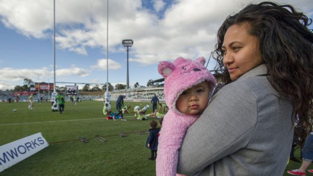 Josh Papalii's mother Mespa Salesa, with his daughter, Khalani-Rose Papalii, watch Raiders players warm up from the side ...