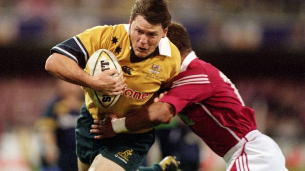 Notorious match: Matt Burke takes on the Lions at the Gabba in 2001.