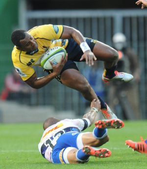 Sent flying: Tevita Kuridrani .
