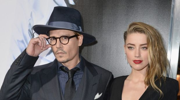 Actor Johnny Depp, pictured with wife Amber Heard, has left Australia, but its for his daughter, not his dogs.