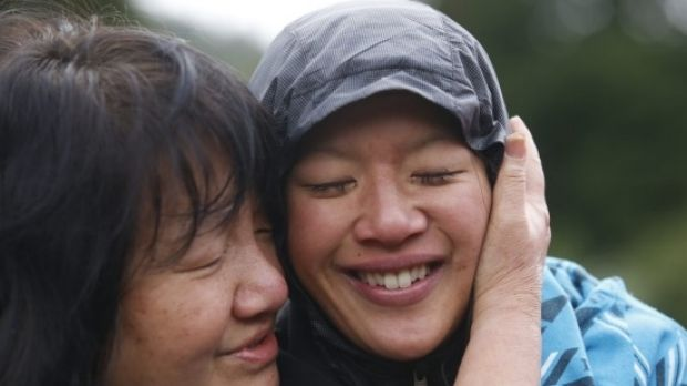 Susan O'Brien is hugged by her mother Maggie Khoo after she was found.