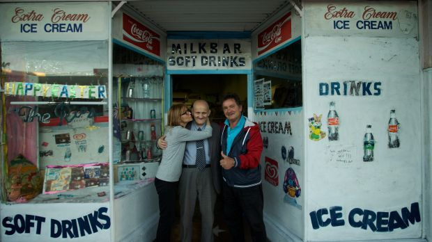 """George Poulos with his daughter, Aphrodite, and son, Nik, outside his milk bar in 2014. """"It gave him something to do — ..."""