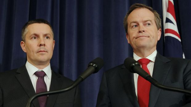 "Bill Shorten, pictured with Labor's environment spokesman Mark Butler, dismissed as ""complete rubbish"" reports that his ..."