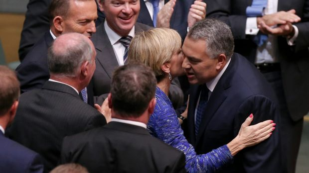 """Business has praised a """"softer, cuddlier budget"""" from Treasurer Joe Hockey, seen here congratulated by Foreign Affairs ..."""