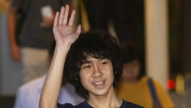 Found guilty: Amos Yee waves as he leaves court on Tuesday.