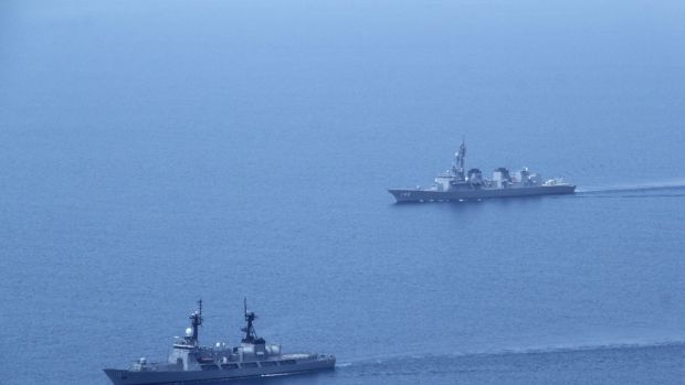 A Japanese Navy ship (right) along with a Philippine Navy vessel take part in a joint exercise less than 300 kilometres ...