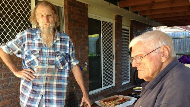 Deception Bay residents Jon Cuffe and his father Tom Cuffe speak out as class action begins against rail construction.