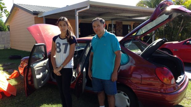 Jasmine Reyes and her father Carlos Reyes in Major Street, Deception Bay: 'We've never had flooding here before.'