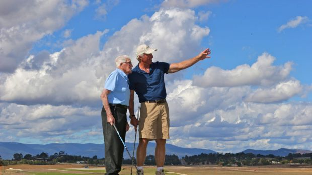 Greg Norman, right, shows Les Smith the 27-hole course he designed for the Eastern Golf club in Yering.