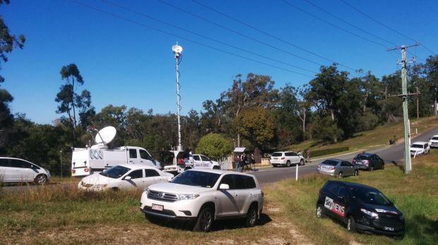 Media wait outside the Gold Coast home.