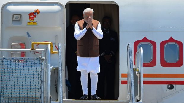 Indian Prime Minister Narendra Modi arrives at Brisbane Airport to attend the G20 Leader's Summit on November 14, 2014. ...