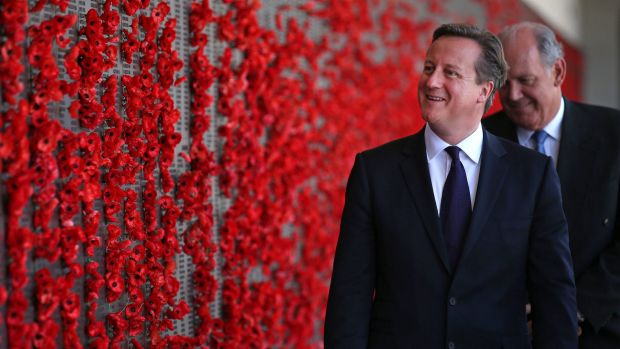 Britain's Prime Minister David Cameron (2nd R) walks along the Roll of Honour in the cloisters at the Australian War ...