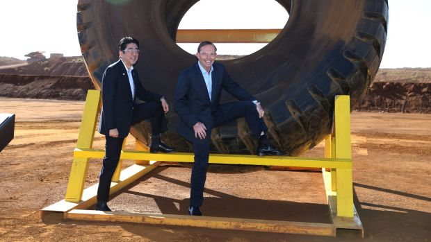 Japanese Prime Minister Shinzo Abe and Prime Minister Tony Abbott during a visit to an iron ore mine in the Plibera.