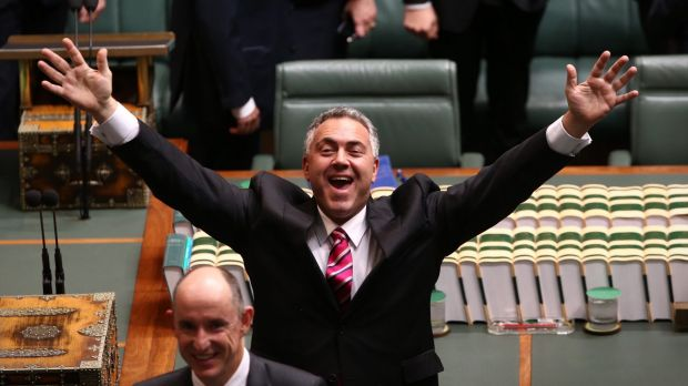 Treasurer Joe Hockey waves to the public gallery ahead of Opposition Leader Bill Shorten delivering the budget in reply ...