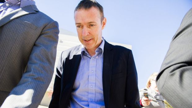 The government's chief NBN adviser Stephen John Ellis leaves the Magistrates Court in Canberra on bail after being ...