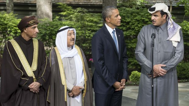 US President Barack Obama (second from right) listens to the emir of Qatar Sheikh Tamim bin Hamad al-Thani (right) at ...