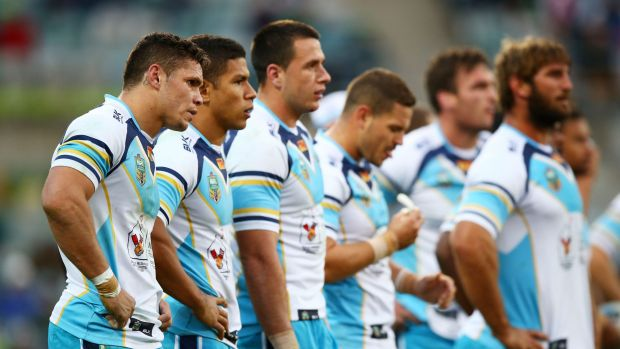 Disappointment: Titans players look dejected after conceding a try last season.