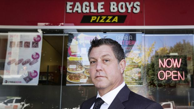 Business consultant Alan Noor poses outside Eagle Boys Pizza in Ryde. Mr Noor is suing the company after it sent an ...