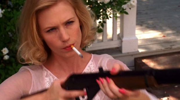 Betty Draper (January Jones) takes aim at her neighbour's pigeons in Mad Men.
