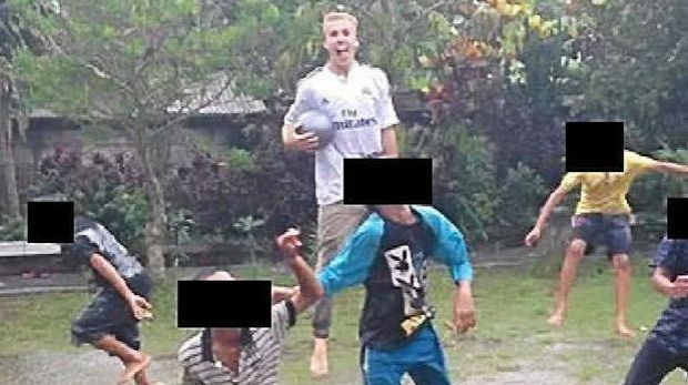 Oliver Bridgeman's Facebook page shows him playing football with children in Bali.