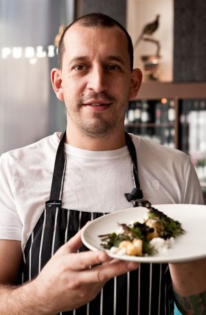 Public Bar and Restaurant head chef Damon Amos shows off a former favourite - wood-roasted scorpions with ˜lobster snow, ...
