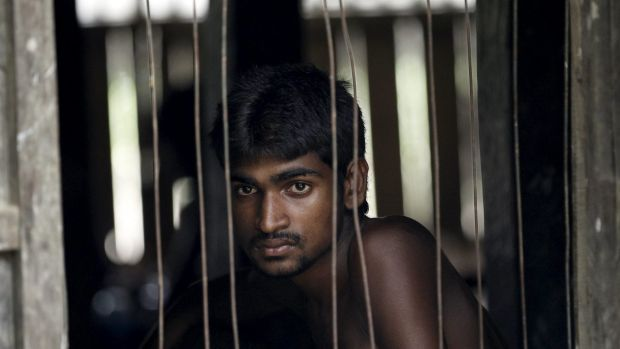 A refugee from Bangladesh, who was rescued by the Myanmar navy, at a Muslim religious school used as a temporary refugee ...