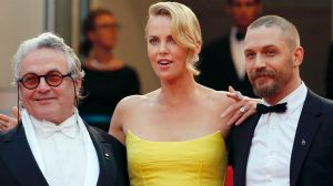 (L-R) Director George Miller, cast members Charlize Theron and Tom Hardy pose on the red carpet as they arrive for the ...