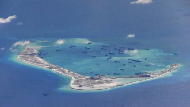 Chinese dredging vessels are purportedly working in the waters around Mischief Reef in the disputed Spratly Islands in ...