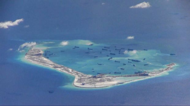Chinese dredging vessels are purportedly seen in the waters around Mischief Reef in the disputed Spratly Islands in the ...