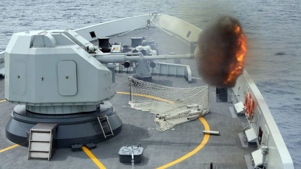 "An anti-surface gun is fired from China's Navy missile frigate Yulin during ""Exercise Maritime Co-operation 2015""."
