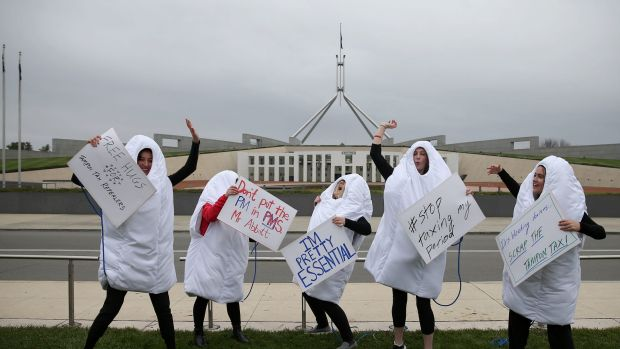 2015: Giant dancing tampons protest against the GST on sanitary products on the front lawn of Parliament House.