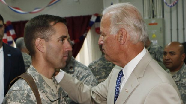 US Vice President Joe Biden, right, talks with his son, then US Army Captain Beau Biden, at Camp Victory on the ...