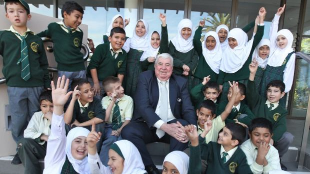 Proud of being Australian: Dr Ray Barrett and students.