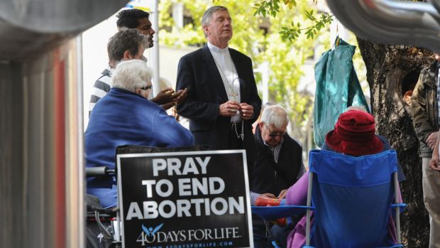 Canberra Goulburn Catholic Archbishop Christopher Prowse leads prayers during the 40 Days for Life campaign outside ...