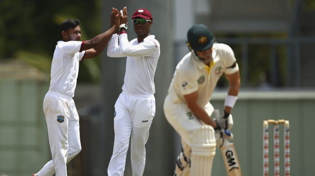 Devendra Bishoo, left, celebrates after taking the wicket of Shane Watson.